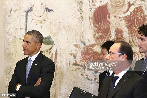 US President Barack Obama and French President Francois Hollande stand in front of the reproduced mural of the Horyuji Temple at the Exhibitions...