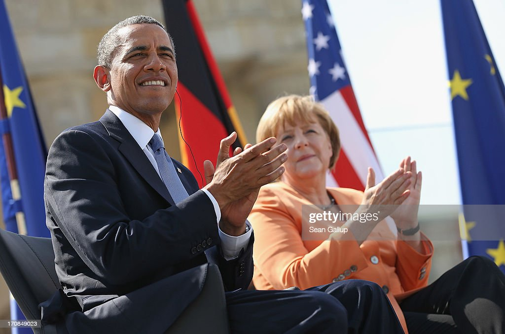 U.S. President <a gi-track='captionPersonalityLinkClicked' href=/galleries/search?phrase=Barack+Obama&family=editorial&specificpeople=203260 ng-click='$event.stopPropagation()'>Barack Obama</a> and German Chancellor <a gi-track='captionPersonalityLinkClicked' href=/galleries/search?phrase=Angela+Merkel&family=editorial&specificpeople=202161 ng-click='$event.stopPropagation()'>Angela Merkel</a> arrive to speak at the Brandenburg Gate on June 19, 2013 in Berlin, Germany. Obama is visiting Berlin for the first time during his presidency and his speech at the Brandenburg Gate is to be the highlight. Obama will be speaking close to the 50th anniversary of the historic speech by then U.S. President John F. Kennedy in Berlin in 1963, during which he proclaimed the famous sentence: 'Ich bin ein Berliner.'