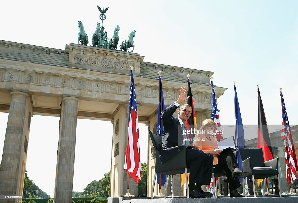 U.S. President Barack Obama and German Chancellor Angela Merkel arrive to speak at the Brandenburg Gate on June 19, 2013 in Berlin, Germany. Obama is visiting Berlin for the first time during his presidency and his speech at the Brandenburg Gate is to be the highlight. Obama will be speaking close to the 50th anniversary of the historic speech by then U.S. President John F. Kennedy in Berlin in 1963, during which he proclaimed the famous sentence: 'Ich bin ein Berliner.'