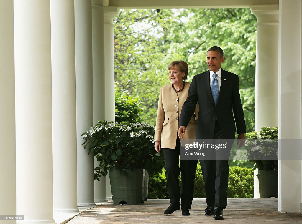 U.S. President <a gi-track='captionPersonalityLinkClicked' href=/galleries/search?phrase=Barack+Obama&family=editorial&specificpeople=203260 ng-click='$event.stopPropagation()'>Barack Obama</a> (R) and German Chancellor <a gi-track='captionPersonalityLinkClicked' href=/galleries/search?phrase=Angela+Merkel&family=editorial&specificpeople=202161 ng-click='$event.stopPropagation()'>Angela Merkel</a> come out from the Oval Office for a joint news conference in the Rose Garden at the White House May 2, 2014 in Washington, DC. Obama and Merkel emphasized their continued support for the new government in Ukraine and their criticism of Russia after the failure of last month's Geneva Agreement. The Ukrainian military said today that pro-Russian militants in the eastern part of the country had used sophisticated weapons to shoot down two of its helicopters.