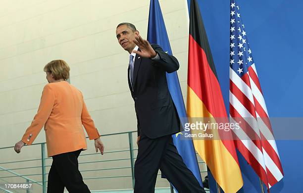 S President Barack Obama and German Chancellor Angela Merkel depart after speaking to the media following bilateral talks at the Chancellery on June...