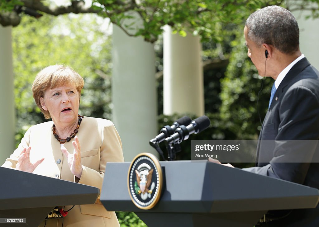 U.S. President <a gi-track='captionPersonalityLinkClicked' href=/galleries/search?phrase=Barack+Obama&family=editorial&specificpeople=203260 ng-click='$event.stopPropagation()'>Barack Obama</a> (R) and German Chancellor <a gi-track='captionPersonalityLinkClicked' href=/galleries/search?phrase=Angela+Merkel&family=editorial&specificpeople=202161 ng-click='$event.stopPropagation()'>Angela Merkel</a> hold a joint news conference in the Rose Garden at the White House May 2, 2014 in Washington, DC. Obama and Merkel emphasized their continued support for the new government in Ukraine and their criticism of Russia after the failure of last month's Geneva Agreement. The Ukrainian military said today that pro-Russian militants in the eastern part of the country had used sophisticated weapons to shoot down two of its helicopters.