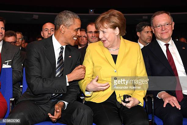 S President Barack Obama and German chancellor Angela Merkel joke around proir to the opening evening of the Hannover Messe trade fair on April 24...