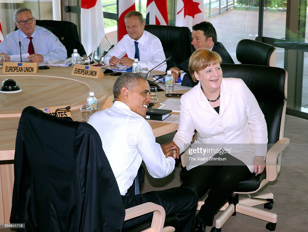 U.S. President Barack Obama and German Chancellor Angela Merkel shake hands at the working session during the Group of Seven summit on May 27, 2016 in Shima, Mie, Japan. The 2-day Group of Seven summit takes place to discuss key global issues such as global economy and counter terrorism measures.