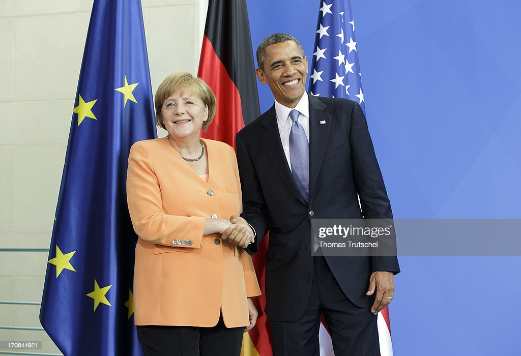 U.S. President <a gi-track='captionPersonalityLinkClicked' href=/galleries/search?phrase=Barack+Obama&family=editorial&specificpeople=203260 ng-click='$event.stopPropagation()'>Barack Obama</a> and German Chancellor <a gi-track='captionPersonalityLinkClicked' href=/galleries/search?phrase=Angela+Merkel&family=editorial&specificpeople=202161 ng-click='$event.stopPropagation()'>Angela Merkel</a> shake hands after speaking to the media following bilateral talks at the Chancellery on June 19, 2013 in Berlin, Germany. Obama is visiting Berlin for the first time during his presidency and his speech at the Brandenburg Gate is to be the highlight. Obama will be speaking close to the 50th anniversary of the historic speech by then U.S. President John F. Kennedy in Berlin in 1963, during which he proclaimed the famous sentence: 'Ich bin ein Berliner.'