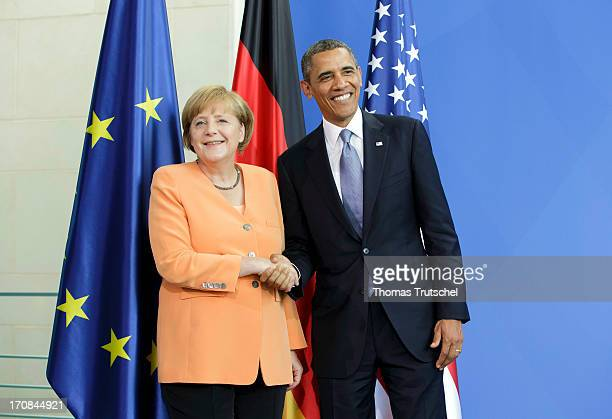S President Barack Obama and German Chancellor Angela Merkel shake hands after speaking to the media following bilateral talks at the Chancellery on...
