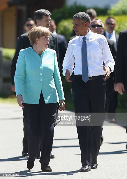 S President Barack Obama and German Chancellor Angela Merkel strill through the village centers before the two leaders were scheduled to continue to...
