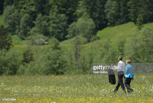 S President Barack Obama and German Chancellor Angela Merkel stroll outside at the summit of G7 nations at Schloss Elmau on June 7 2015 near...