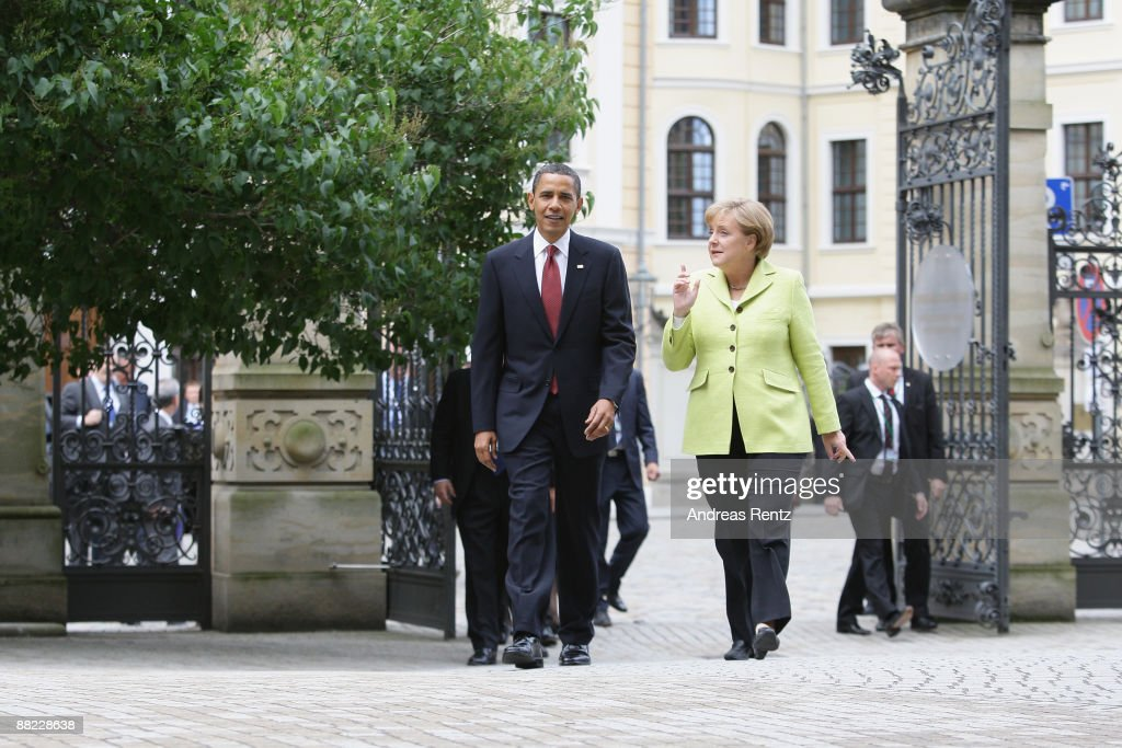 U.S. President <a gi-track='captionPersonalityLinkClicked' href=/galleries/search?phrase=Barack+Obama&family=editorial&specificpeople=203260 ng-click='$event.stopPropagation()'>Barack Obama</a> (L) and German Chancellor <a gi-track='captionPersonalityLinkClicked' href=/galleries/search?phrase=Angela+Merkel&family=editorial&specificpeople=202161 ng-click='$event.stopPropagation()'>Angela Merkel</a> walk towards the 'Historical Gruenes Gewoelbe, (Green Vault) on June 5, 2009 in Dresden, Germany. Obama will visit during his 2-day visit Dresden's Frauenkirche (Church of Our Lady) and Buchenwald, a former Nazi concentration camp.