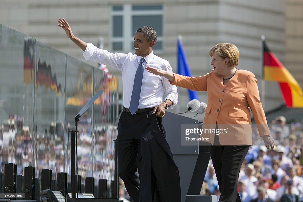 U.S. President <a gi-track='captionPersonalityLinkClicked' href=/galleries/search?phrase=Barack+Obama&family=editorial&specificpeople=203260 ng-click='$event.stopPropagation()'>Barack Obama</a> (L) and German Chancellor <a gi-track='captionPersonalityLinkClicked' href=/galleries/search?phrase=Angela+Merkel&family=editorial&specificpeople=202161 ng-click='$event.stopPropagation()'>Angela Merkel</a> wave as they leave the stage at the Brandenburg Gate on June 19, 2013 in Berlin, Germany. Obama spoke on the east side of the Brandenburg Gate, 50 years after John F. Kennedy famously declared his solidarity with the citizens of Berlin.