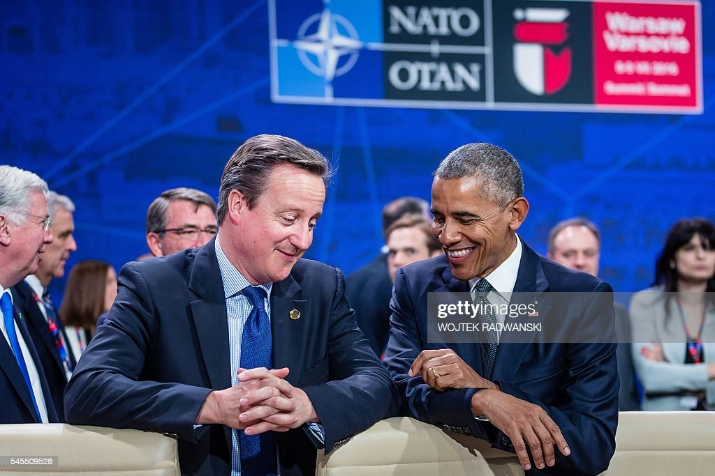 President Barack Obama and Great Britain's Prime Minister David Cameron chat prior to the meeting of the heads of states of the North Atlantic...