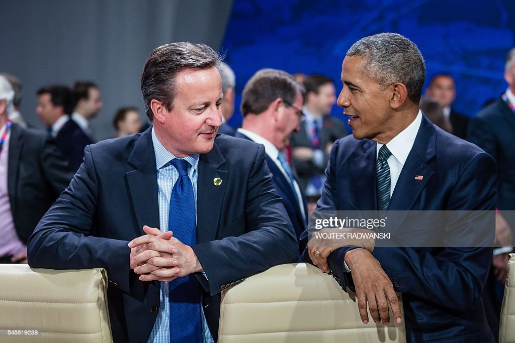 US President Barack Obama and Great Britain's Prime Minister David Cameron chat prior to the meeting of the heads of states of the North Atlantic...