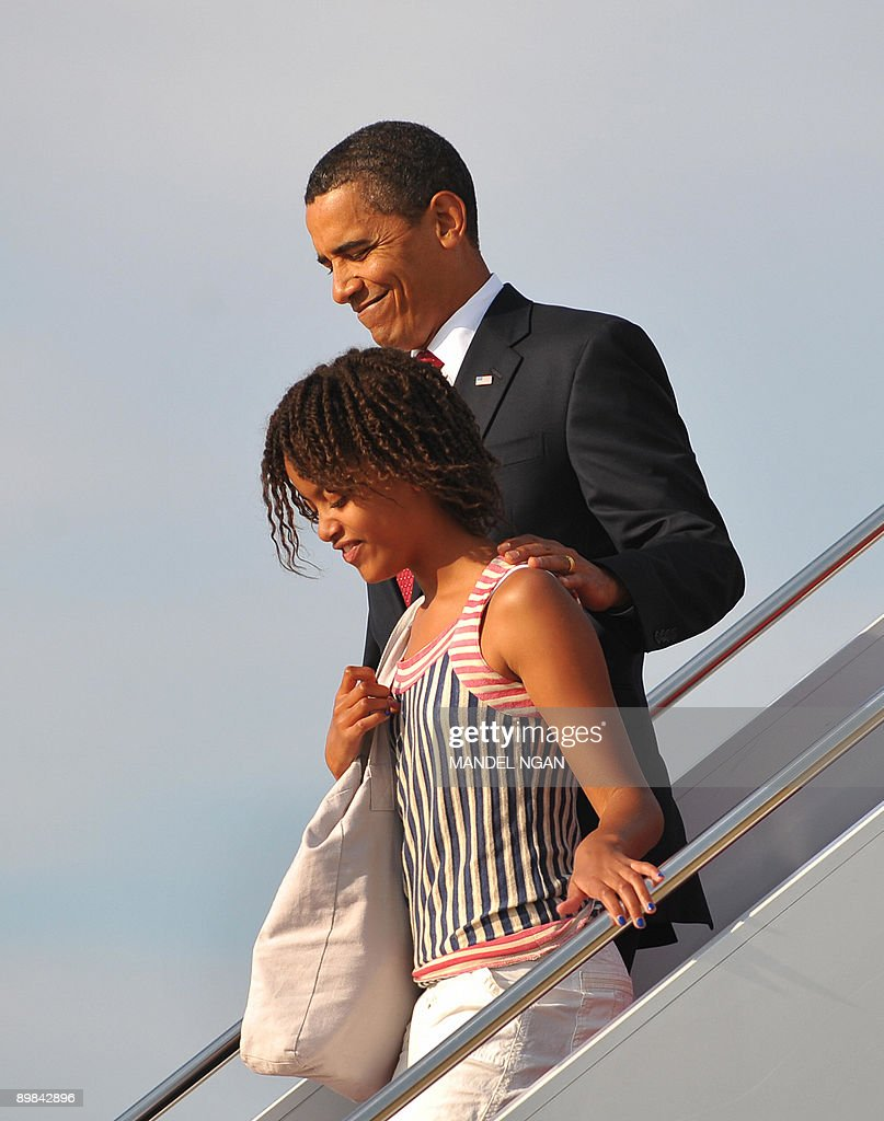 US President <a gi-track='captionPersonalityLinkClicked' href=/galleries/search?phrase=Barack+Obama&family=editorial&specificpeople=203260 ng-click='$event.stopPropagation()'>Barack Obama</a> and his daughter Malia (L) step off Air Force One upon arrival at Andrews Air Force Base in Maryland. Obama and his family returned to Washington after a weekend visit to Montana, Wyoming, Colorado and Arizona. AFP PHOTO/Mandel NGAN