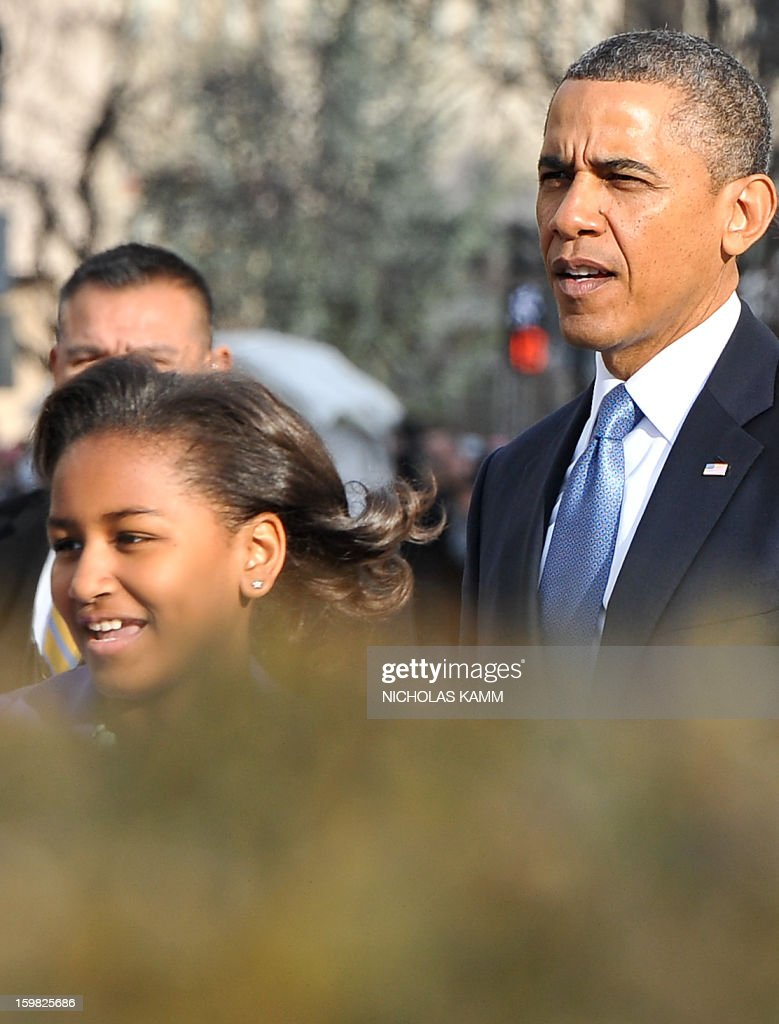 US President Barack Obama and his daughter Sasha leave St. John's Church on January 21, 2013 in Washington, DC, hours before Obama participates in a ceremonial swearing in for a second term in office. AFP PHOTO/Nicholas KAMM