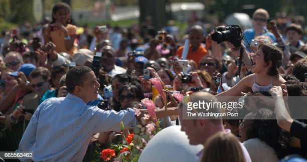 President Barack Obama and his family greets hundreds of people attending the annual Easter Egg Roll on the South Lawn of the White House Photos...