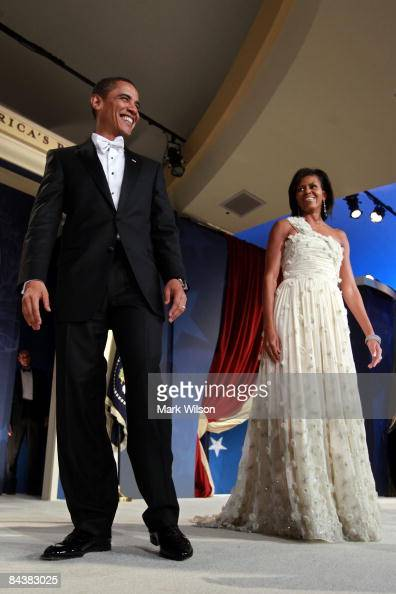 President Barack Obama and his wife First Lady Michelle Obama arrive on stage during MTV ServiceNation Live From The Youth Inaugural Ball at the...