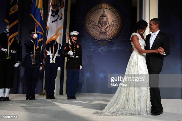 President Barack Obama and his wife First Lady Michelle Obama dance on stage during MTV ServiceNation Live From The Youth Inaugural Ball at the...