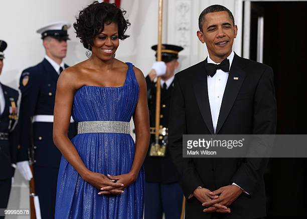 President Barack Obama and his wife first lady Michelle Obama wait to greet Mexican President Felipe Calderon and his wife Margarita Zavala as they...
