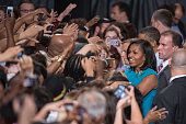 President Barack Obama and his wife Michele speak to supporters at a campaign rally at the Value City Arena on the campus of Ohio State University in...
