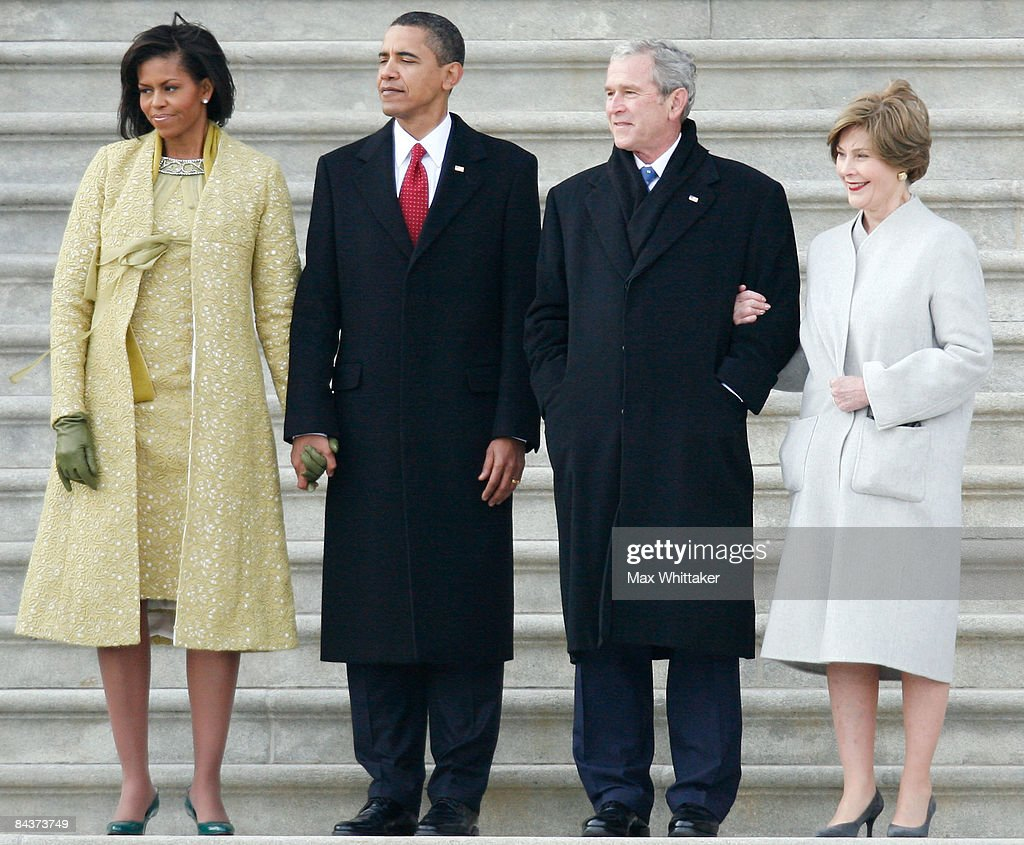 President Barack Obama and his wife Michelle escort departing former president George W Bush and his wife Laura to a waiting helicopter after the...