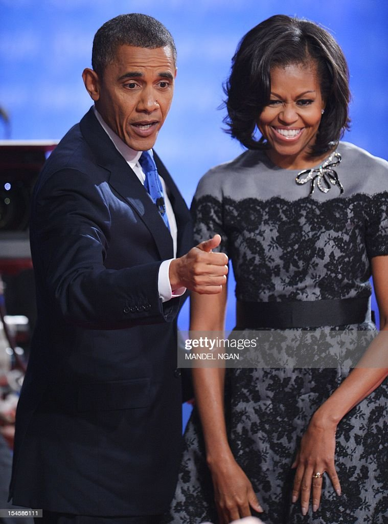US President Barack Obama and his wife Michelle greet attendees at the end of the third and final presidential debate October 22 2012 at Lynn...