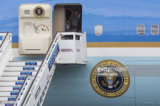 President Barack Obama and his wife Michelle Obama leave official plane 'Air Force One' as it landed Jose Marti International Airport during the...