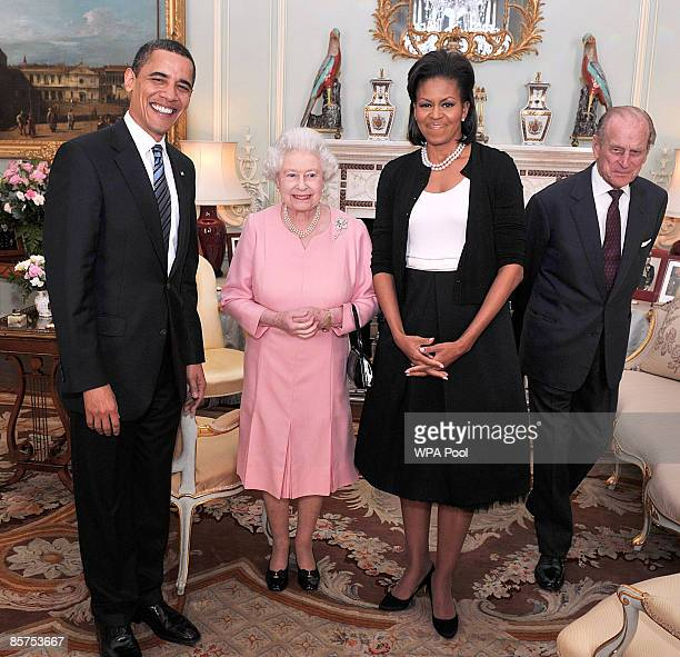President Barack Obama and his wife Michelle Obama pose for photographs with Queen Elizabeth II and Prince Philip Duke of Edinburgh during an...
