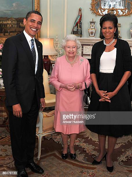 President Barack Obama and his wife Michelle Obama pose with Queen Elizabeth II at a reception at Buckingham Palace on April 1 2009 in London England