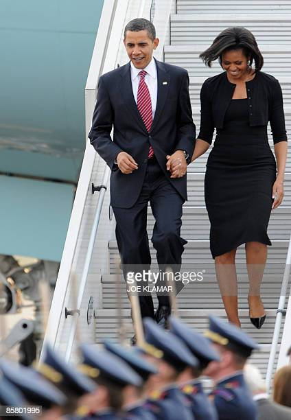 US President Barack Obama and his wife Michelle Obama step off Air Force One on April 4 2009 upon arrival in Prague Obama flew into Prague ahead of a...