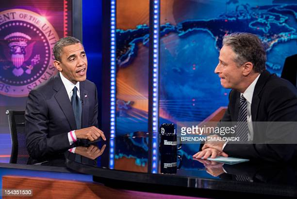 US President Barack Obama and host Jon Stewart speak during a break in the live taping of Comedy Central's 'Daily Show with Jon Stewart' on October...