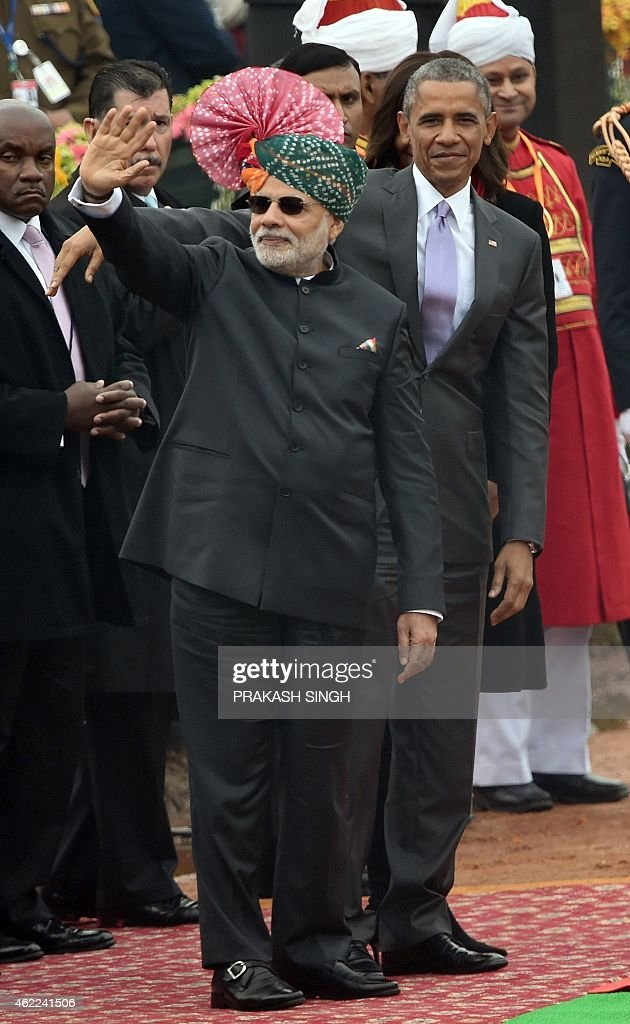 US President Barack Obama and Indian Prime Minister Narendra Modi wave to spectators after attending India's Republic Day parade on Rajpath in New...