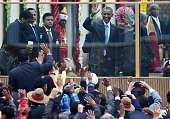 US President Barack Obama and Indian Prime Minister Narendra Modi wave to spectators attending the nation's Republic Day parade in New Delhi on...