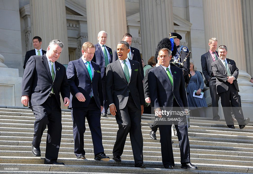 US President Barack Obama (2R) and Irish Prime Minister Enda Kenny (2L) are escorted by US House Speaker John Boehner (R) as they leave the US Capitol after attending a St. Patrick's Day lunch in Washington, DC, on March 19, 2013. AFP PHOTO/Jewel Samad