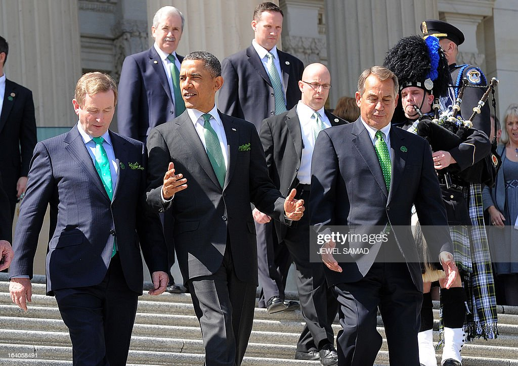 US President Barack Obama (C) and Irish Prime Minister Enda Kenny (L) are escorted by US House Speaker John Boehner (R) as they leave the US Capitol after attending a St. Patrick's Day lunch in Washington, DC, on March 19, 2013. AFP PHOTO/Jewel Samad