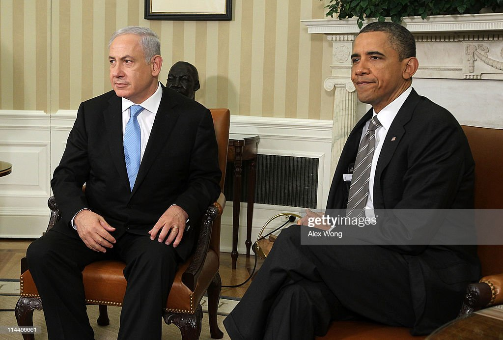 U.S. President <a gi-track='captionPersonalityLinkClicked' href=/galleries/search?phrase=Barack+Obama&family=editorial&specificpeople=203260 ng-click='$event.stopPropagation()'>Barack Obama</a> (R) and Israeli Prime Minister <a gi-track='captionPersonalityLinkClicked' href=/galleries/search?phrase=Benjamin+Netanyahu&family=editorial&specificpeople=118594 ng-click='$event.stopPropagation()'>Benjamin Netanyahu</a> (L) prepare to make statements after their meeting May 20, 2011 in the Oval Office of the White House in Washington, DC. The two leaders were expected to discuss President Obama's suggestion of Israel reverting to the pre-1967 borders as the base for Israel and Palestine to negotiate a two-state solution.