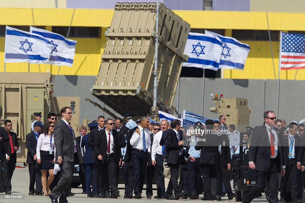 US President Barack Obama and Israel's Prime Minister Benjamin Netanyahu walk away after visiting an Iron Dome missile battery at the Ben Gurion Airport on March, 20, 2013 near Tel Aviv, Israel. This will be Obama's first visit as President to the region, and his itinerary will include meetings with the Palestinian and Israeli leaders as well as a visit to the Church of the Nativity in Bethlehem.