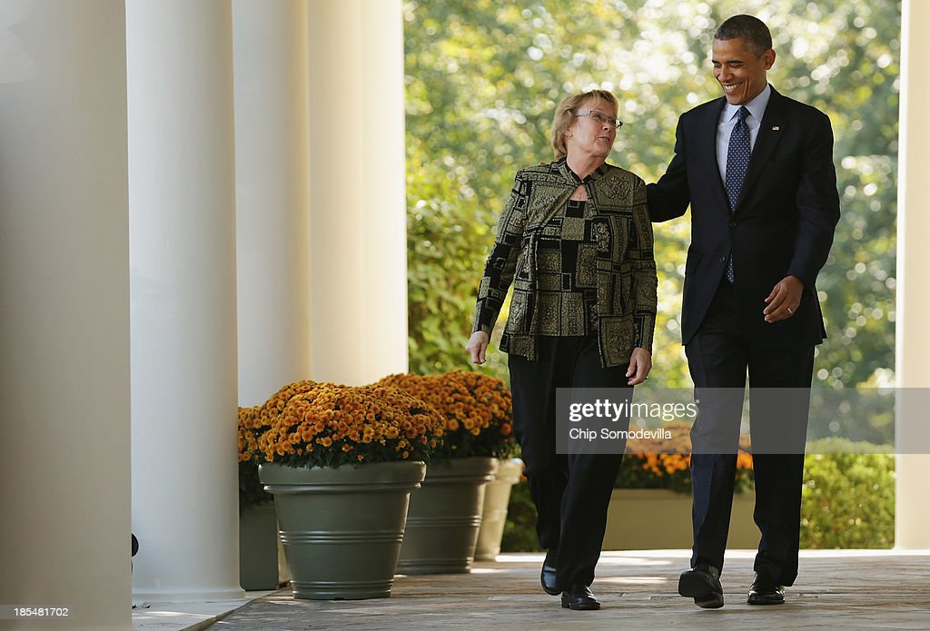 U.S. President <a gi-track='captionPersonalityLinkClicked' href=/galleries/search?phrase=Barack+Obama&family=editorial&specificpeople=203260 ng-click='$event.stopPropagation()'>Barack Obama</a> (R) and Janice Baker of Shelbyville, Delaware, walk out of the Oval Office before Obama delivers remarks about the error-plagued launch of the Affordable Care Act's online enrollment website in the Rose Garden of the White House October 21, 2013 in Washington, DC. According to the White House, the president was joined by 'consumers, small business owners, and pharmacists who have either benefitted from the health care law already or are helping consumers learn about what the law means for them and how they can get covered. 'Despite the new health care law's website problems, Obama urged Americans not to be deterred from registering for Obamacare because of the technological problems that have plagued its rollout.