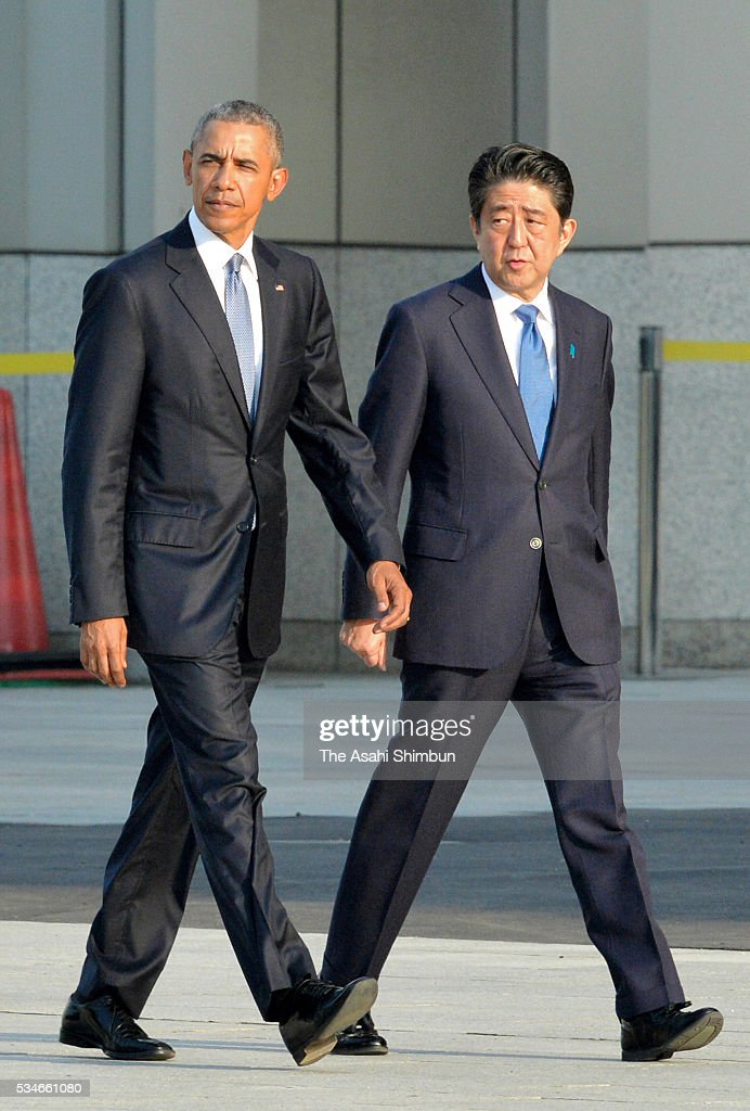 U.S. President <a gi-track='captionPersonalityLinkClicked' href=/galleries/search?phrase=Barack+Obama&family=editorial&specificpeople=203260 ng-click='$event.stopPropagation()'>Barack Obama</a> and Japanese Prime Minister <a gi-track='captionPersonalityLinkClicked' href=/galleries/search?phrase=Shinzo+Abe&family=editorial&specificpeople=559017 ng-click='$event.stopPropagation()'>Shinzo Abe</a> are seen on arrival at the Hiroshima Peace Memorial Park on May 27, 2016 in Hiroshima, Japan. Obama becomes the first sitting U.S. president to visit Hiroshima, where the first atomic bomb was dropped in 1945 at the end of World War II.