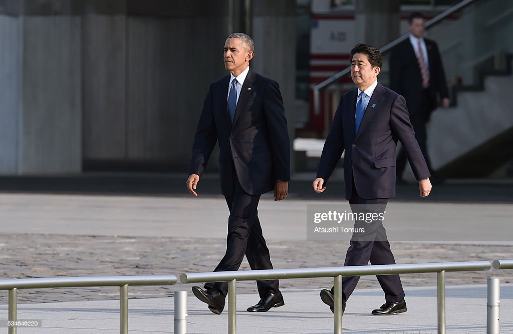 U.S. President <a gi-track='captionPersonalityLinkClicked' href=/galleries/search?phrase=Barack+Obama&family=editorial&specificpeople=203260 ng-click='$event.stopPropagation()'>Barack Obama</a> (L) and Japanese Prime Minister <a gi-track='captionPersonalityLinkClicked' href=/galleries/search?phrase=Shinzo+Abe&family=editorial&specificpeople=559017 ng-click='$event.stopPropagation()'>Shinzo Abe</a> (R) arrive at the Hiroshima Peace Memorial Park on May 27, 2016 in Hiroshima, Japan. It is the first time U.S. President makes an official visit to Hiroshima, the site where the atomic bomb was dropped in the end of World War II on August 6, 1945.