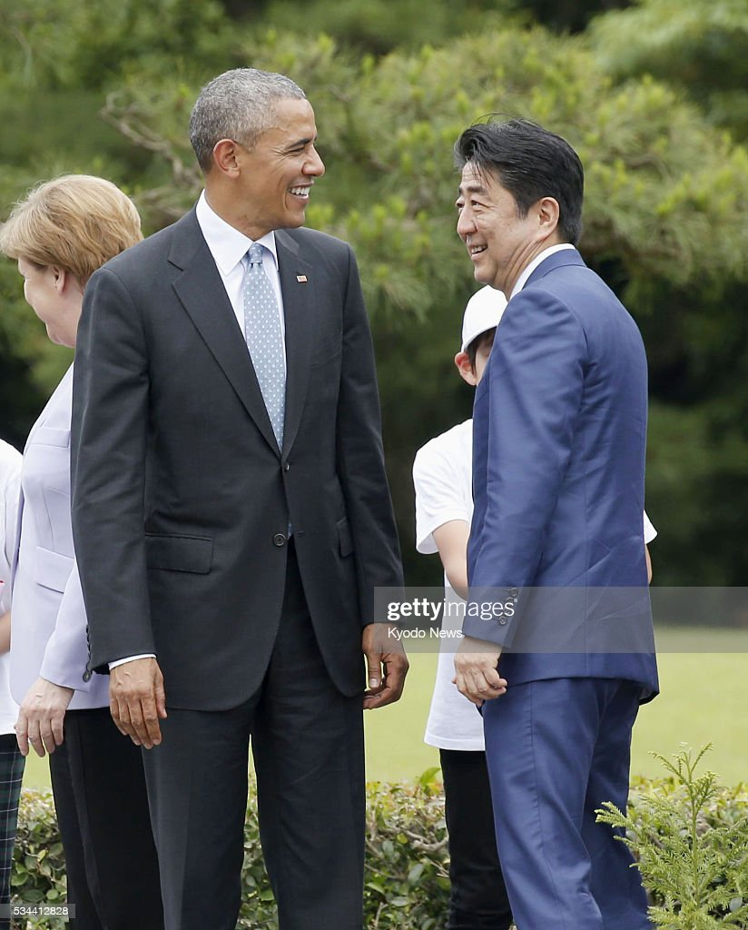 U.S. President <a gi-track='captionPersonalityLinkClicked' href=/galleries/search?phrase=Barack+Obama&family=editorial&specificpeople=203260 ng-click='$event.stopPropagation()'>Barack Obama</a> (L) and Japanese Prime Minister <a gi-track='captionPersonalityLinkClicked' href=/galleries/search?phrase=Shinzo+Abe&family=editorial&specificpeople=559017 ng-click='$event.stopPropagation()'>Shinzo Abe</a> chat after planting trees at Ise Jingu shrine in Ise, Japan on May 26, 2016. The Group of Seven leaders are expected to agree to implement flexible fiscal strategies and promote structural reforms to spur global growth during their just-started two-day meeting.