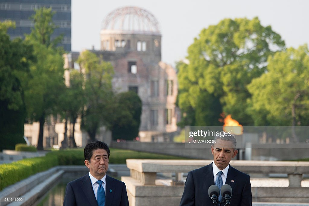 US President Barack Obama and Japanese Prime Minister Shinzo Abe deliver remarks after laying wreaths at the Hiroshima Peace Memorial Park in Hiroshima on May 27, 2016. Obama on May 27 paid moving tribute to victims of the world's first nuclear attack. WATSON