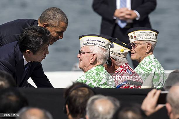 S President Barack Obama and Japanese Prime Minister Shinzo Abe greet Pearl Harbor survivors Emmet Hyland Al Rodriguez and Sterling Cane at Joint...
