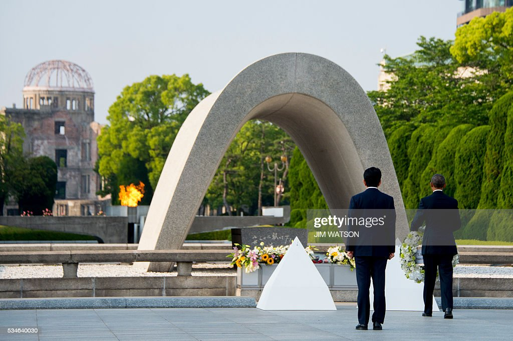 US President Barack Obama (R) and Japanese Prime Minister Shinzo Abe lay wreaths at the Hiroshima Peace Memorial Park in Hiroshima on May 27, 2016. Obama on May 27 paid moving tribute to victims of the world's first nuclear attack. WATSON