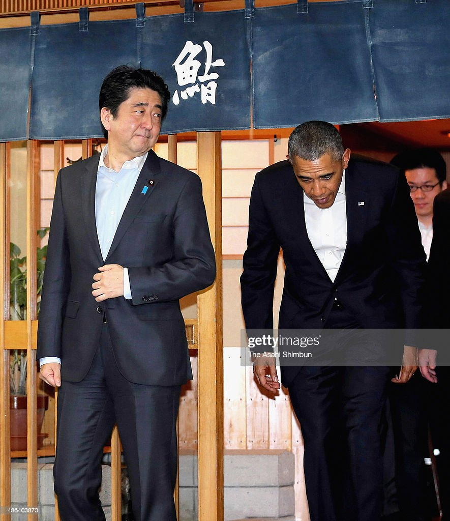 U.S. President Barack Obama and Japanese Prime Minister Shinzo Abe leave the three-star sushi restaurant 'Sukiyabashi Jiro' after their dinner on April 23, 2014 in Tokyo, Japan. The U.S. President is on an Asian tour where he is due to visit Japan, South Korea, Malaysia and Philippines.