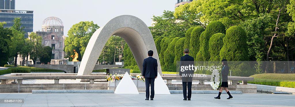 US President Barack Obama (C) and Japanese Prime Minister Shinzo Abe (C) prepare to lay wreaths during a visit to the Hiroshima Peace Memorial Park in Hiroshima on May 27, 2016. Obama on May 27 paid moving tribute to victims of the world's first nuclear attack. WATSON