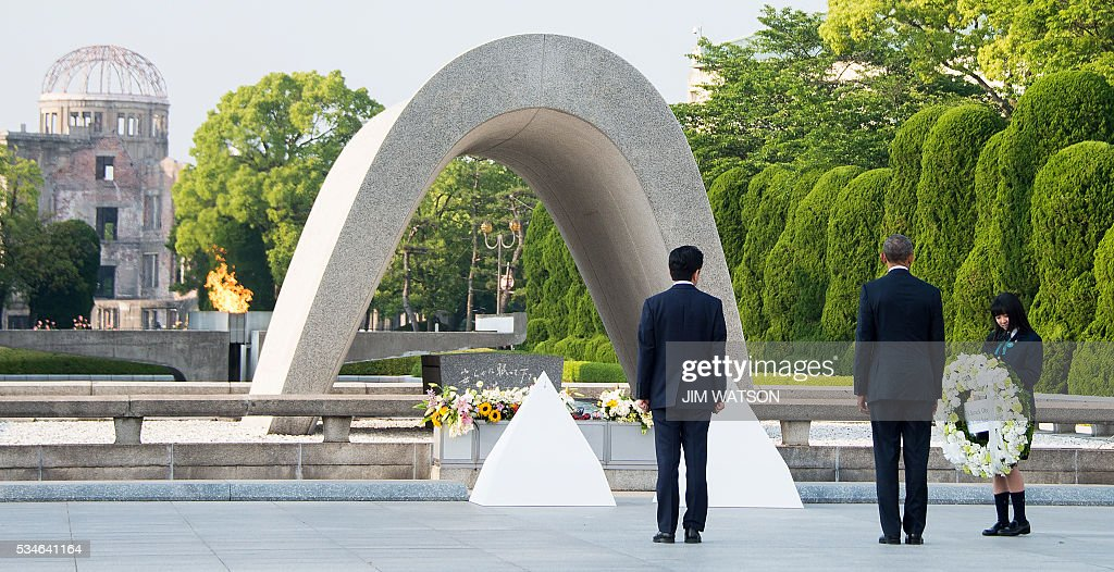 US President Barack Obama (2nd R) and Japanese Prime Minister Shinzo Abe (C) prepare to lay wreaths during a visit to the Hiroshima Peace Memorial Park in Hiroshima on May 27, 2016. Obama on May 27 paid moving tribute to victims of the world's first nuclear attack. WATSON