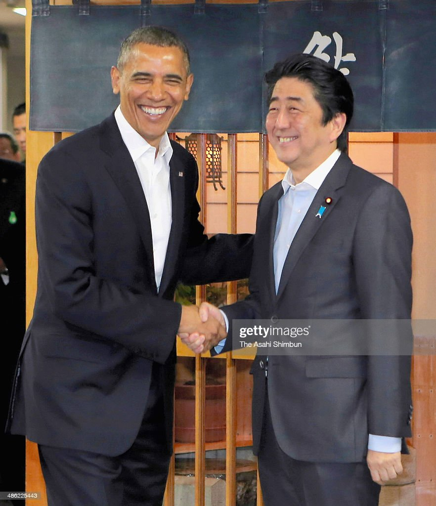 U.S. President <a gi-track='captionPersonalityLinkClicked' href=/galleries/search?phrase=Barack+Obama&family=editorial&specificpeople=203260 ng-click='$event.stopPropagation()'>Barack Obama</a> and Japanese Prime Minister <a gi-track='captionPersonalityLinkClicked' href=/galleries/search?phrase=Shinzo+Abe&family=editorial&specificpeople=559017 ng-click='$event.stopPropagation()'>Shinzo Abe</a> shake hands in front of the three-star sushi restaurant 'Sukiyabashi Jiro' on April 23, 2014 in Tokyo, Japan. The U.S. President is on an Asian tour where he is due to visit Japan, South Korea, Malaysia and Philippines.