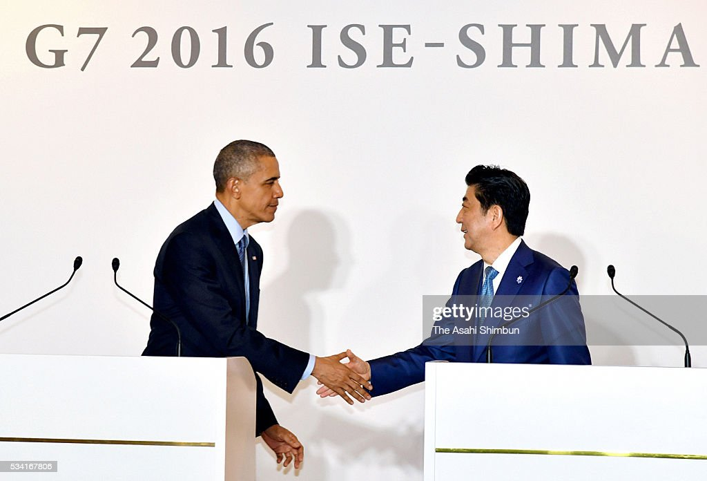 U.S. President Barack Obama (L) and Japanese Prime Minister Shinzo Abe (R) shake hands after a joint press conference following their bilateral meeting ahead of the Group of Seven summit on May 25, 2016 in Shima, Mie, Japan. Obama expressed deep remorse for the recent incident in which a U.S. civilian working at a U.S. military base was arrested in connection with the slaying of a young woman in Okinawa. The Group of Seven summit takes place on May 26 and 27 to discuss key global issues such as global economy and anti terrorism measures.