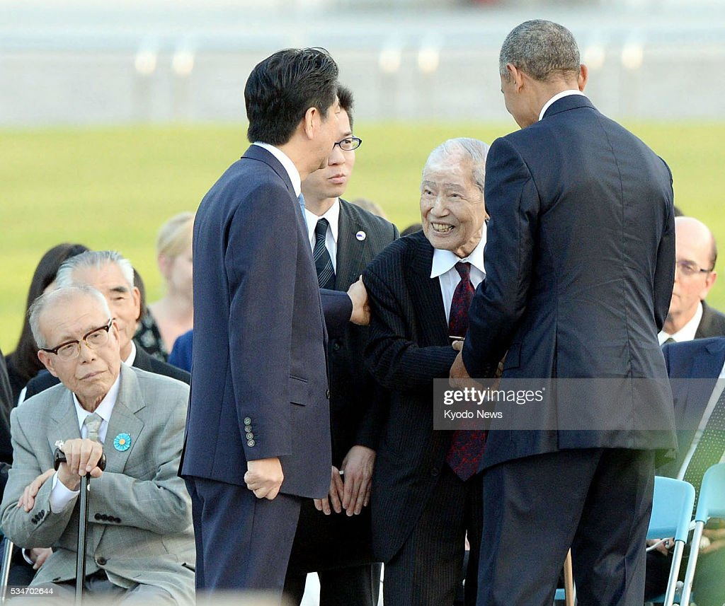 U.S. President <a gi-track='captionPersonalityLinkClicked' href=/galleries/search?phrase=Barack+Obama&family=editorial&specificpeople=203260 ng-click='$event.stopPropagation()'>Barack Obama</a> (front R) and Japanese Prime Minister <a gi-track='captionPersonalityLinkClicked' href=/galleries/search?phrase=Shinzo+Abe&family=editorial&specificpeople=559017 ng-click='$event.stopPropagation()'>Shinzo Abe</a> (front L) talk with Sunao Tsuboi, a 91-year-old survivor of the U.S. atomic bombing, while Shigeaki Mori (far L), a 79-year-old survivor, looks on, in the Peace Memorial Park in Hiroshima on May 27, 2016. Obama became the first sitting U.S. president to visit the atomic-bombed city that day.