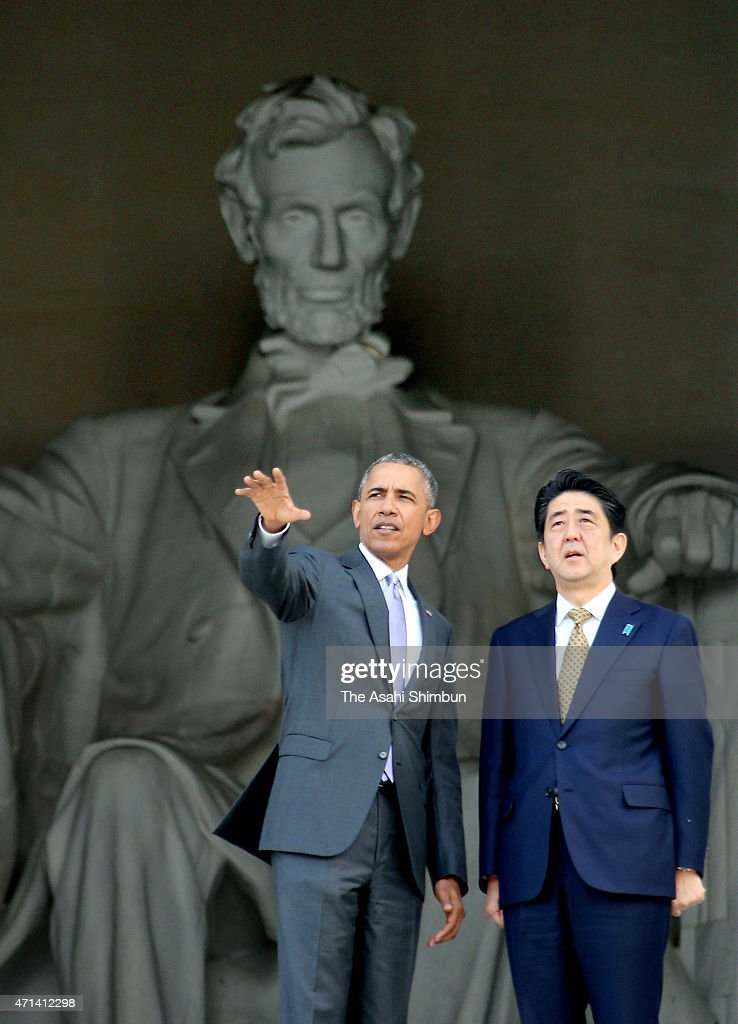 US President Barack Obama and Japanese Prime Minister Shinzo Abe turn to look across the reflecting pool as they visit the Lincoln Memorial on April...